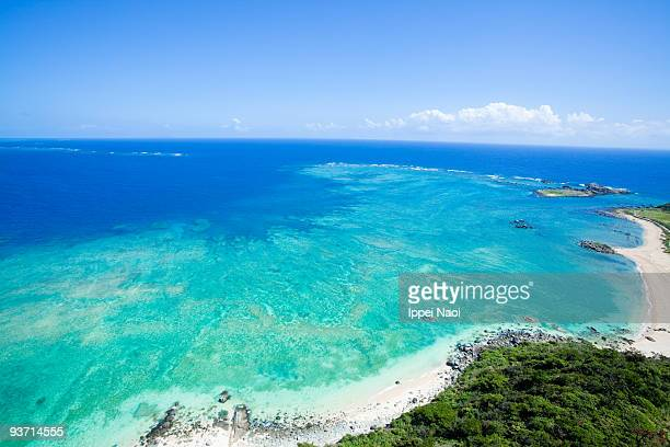 tropical island and coral reef from above, okinawa - 沖縄県 ストックフォトと画像