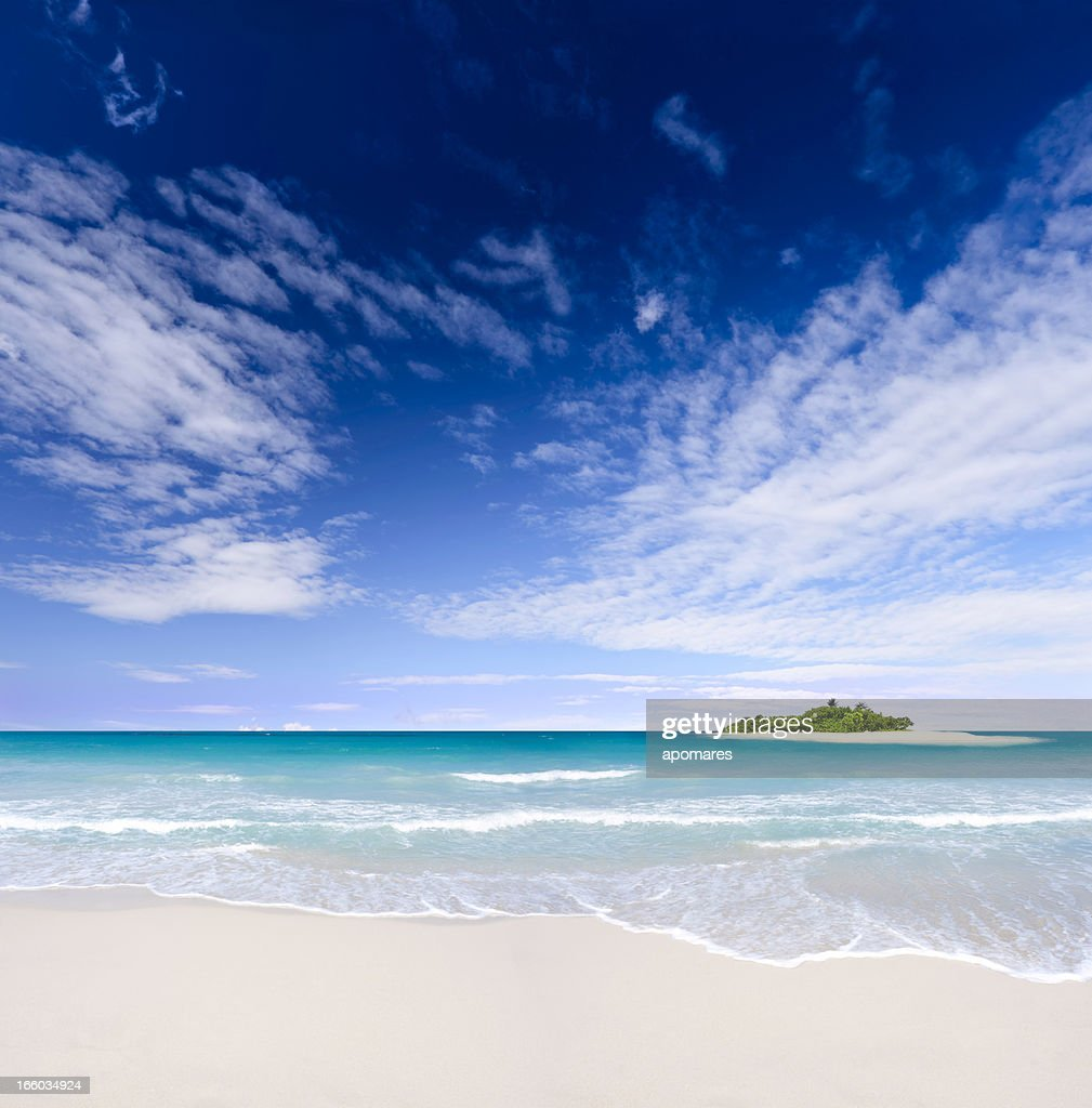 Tropical Beach And Peaceful Ocean: Tropical Island Beach With Deep Blue Sky Over The Ocean