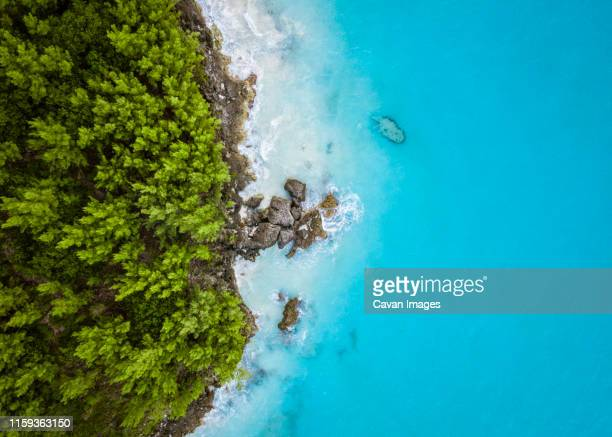 a tropical island from above - bermuda stock pictures, royalty-free photos & images