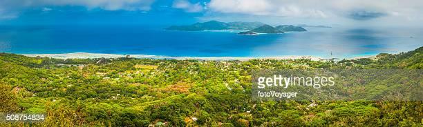 Tropical island green jungle overlooking blue Indian Ocean panorama Seychelles