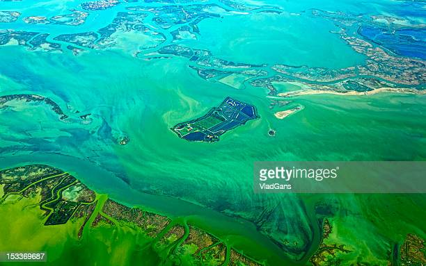 tropical island in the sea. aerial view - vladgans or gansovsky stock pictures, royalty-free photos & images