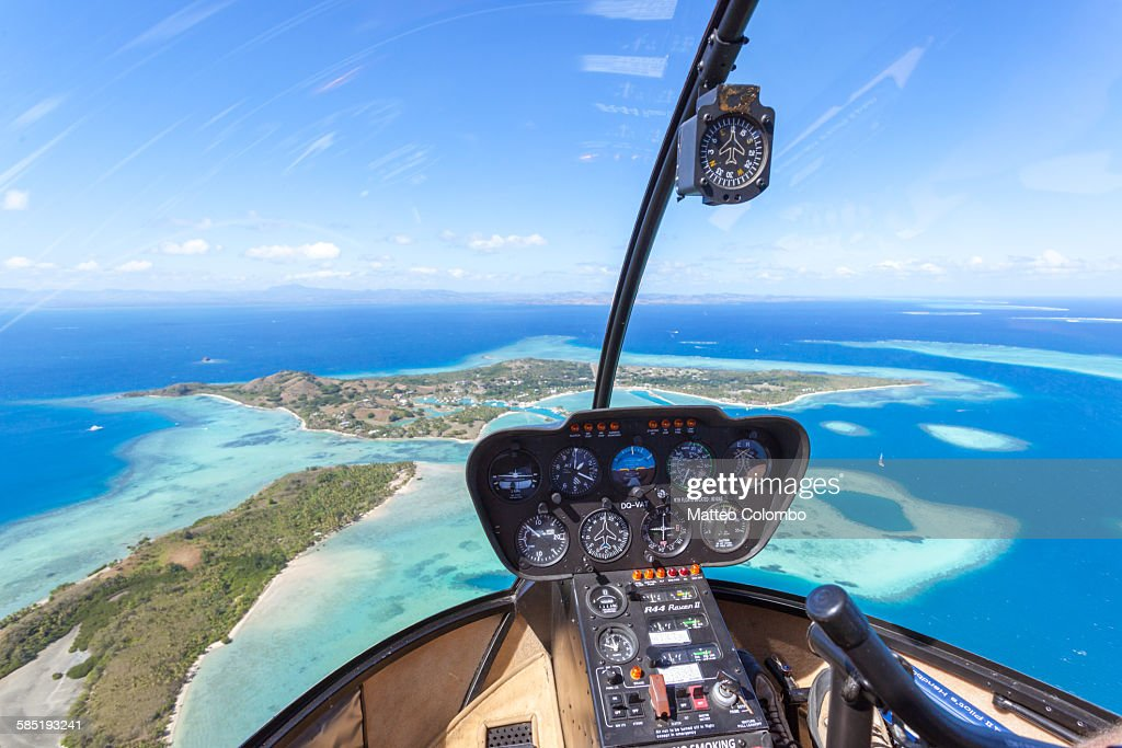 Tropical island seen from helicopter cockpit, Fiji : Stock Photo