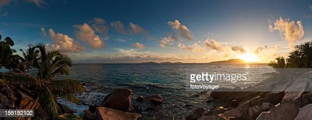 Tropical island sunrise idyllic ocean shore panorama