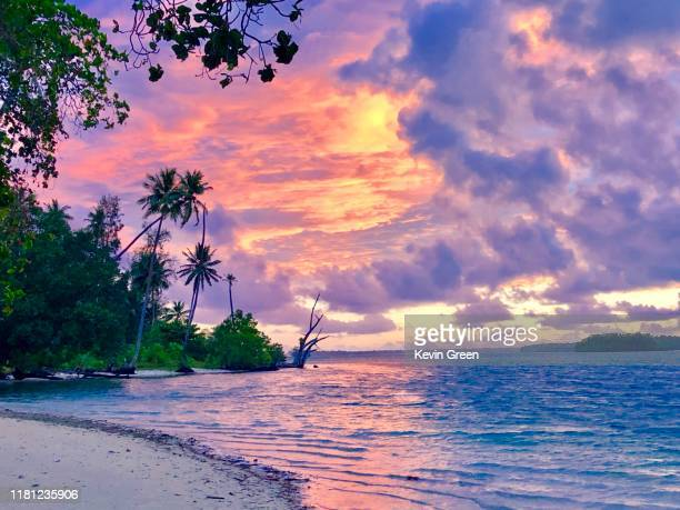 tropical island sunset - solomon islands stock pictures, royalty-free photos & images