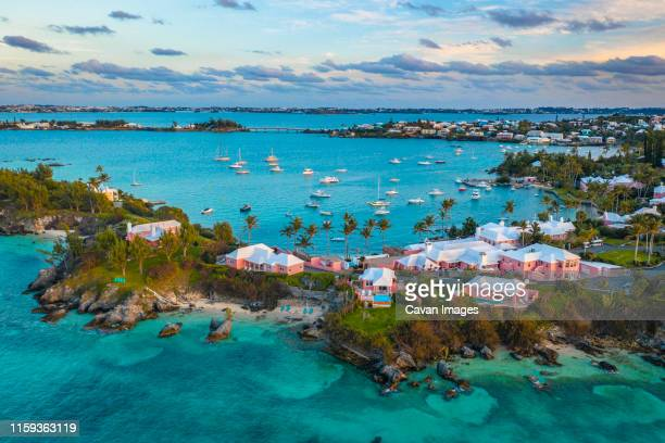 a tropical island with yachts and houses in bermuda - bermuda stock pictures, royalty-free photos & images
