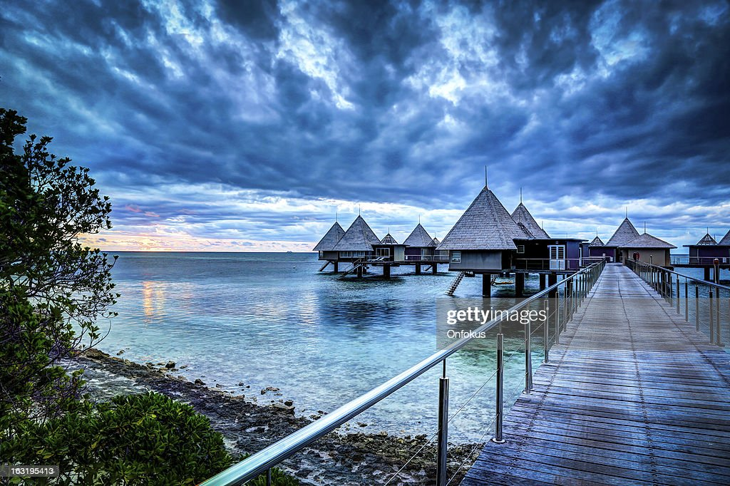Tropical Paradise Luxury Over Water Resort at Sunset : Stock Photo