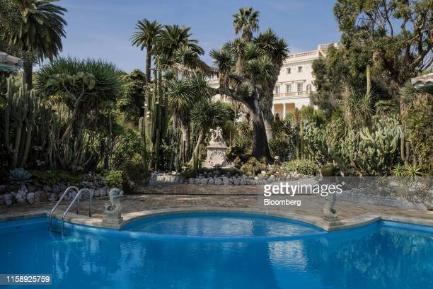Tropical plants surround a swimming pool in the private gardens at the Villa Les Cedres a 187yearold000squarefoot 14bedroom mansion set on 35 acres...