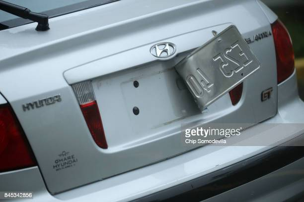 Tropical storm winds peel a license plate away from a car as Hurricane Irma hits the southern part of the state September 10 2017 in Fort Lauderdale...