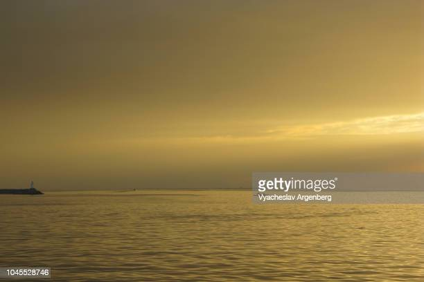 tropical sunset in manila, philippines - argenberg stock pictures, royalty-free photos & images