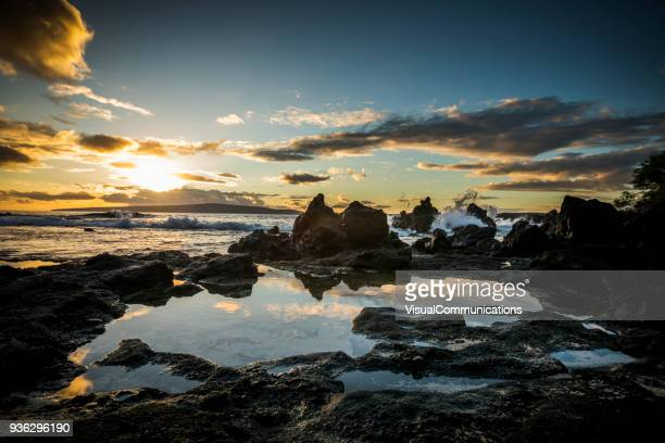 tropical sunset on beach in maui. - sunset beach stock photos and pictures