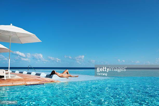 tropical vacation resort hotel relaxing in infinity pool hz - mayan riviera stock photos and pictures