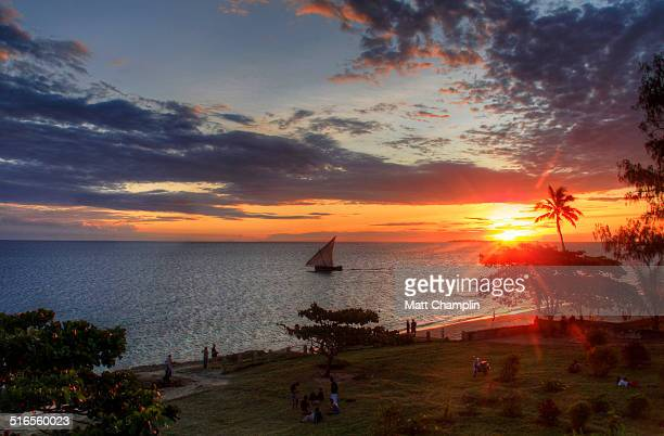 tropical zanzibar sunset with boat - zanzibar island stock photos and pictures