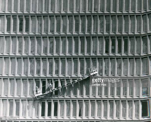 Trouble High Over Denver Leo Benn a foreman for the American Janitorial Service Co had precarious job of mounting a window washers' scaffold high on...
