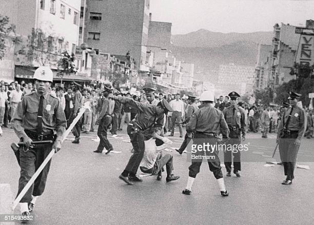Trouble in Caracas Caracas Venezuela Caracas policemen close in on one young demonstrator during the fighting that erupted April 1 during an...