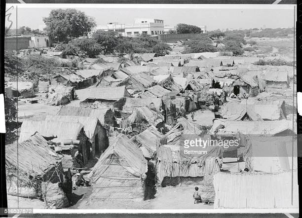 """Trouble in the """"Land of the Pure."""" Karachi, Pakistan: This is one of the squatter colonies common in both East and West Pakistan. With a population..."""