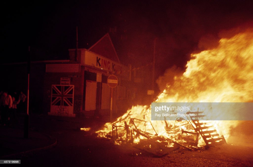 Trouble on the streets takes the form of a bonfire after a day of marching by the Orange Order, a Protestant fraternal organisation, in Belfast, Northern Ireland, circa July 1971.