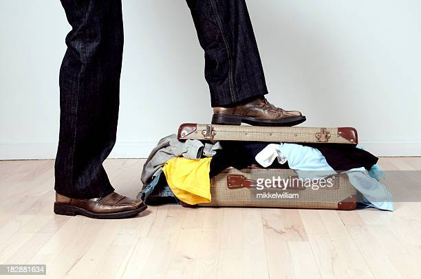 Trouble Packing suitcase and using foot to close it