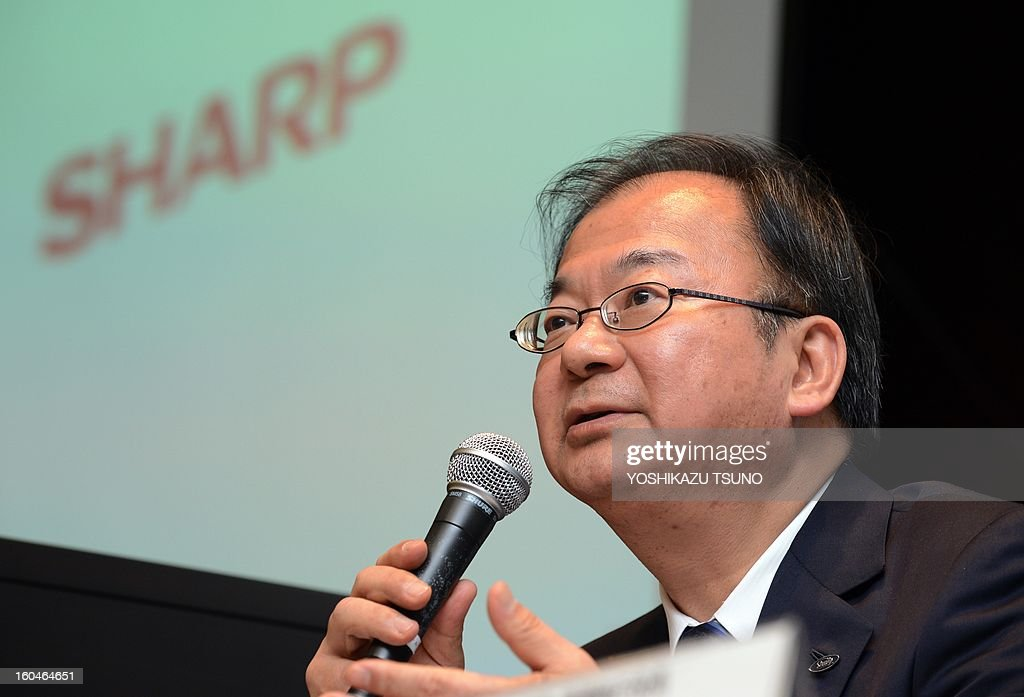 Troubled Japanese electronics giant Sharp president Takashi Okuda announces the company's third-quarter financial results in Tokyo on February 1, 2013