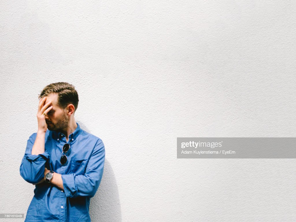 Troubled Man Against White Background : Stock Photo