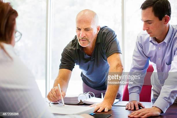 Troubled man pointing to small print on contract