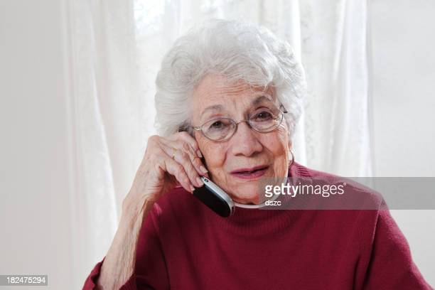 troubled senior woman talking on phone