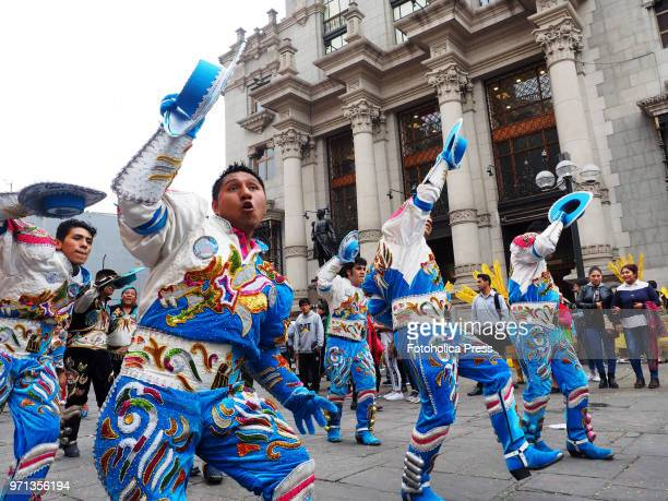 A troup in traditional dress dancing morenada during the grand parade in the downtown of Lima for the 69th anniversary of the National Superior...