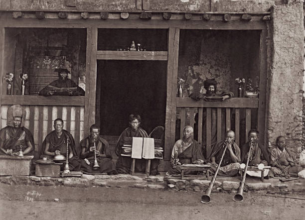 A troupe of musicians outside a Buddhist temple in...