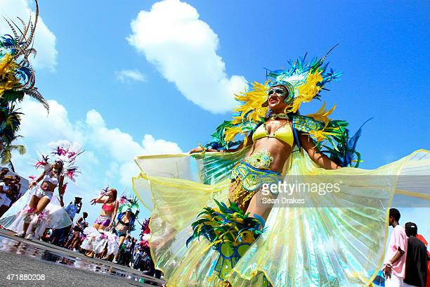 Troupes of masqueraders display colorful and feathered costumes while performing during the Labor Day Parade at Carnival on May 1 2015 in Philipsburg...