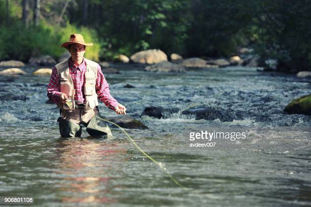 trout fishing - fly fishing stock photos and pictures