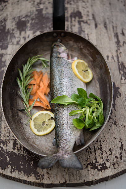 Trout With Carrots And Lemon In A Pan Wall Art