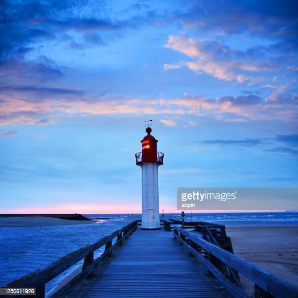trouville-sur-mer lighthouse, france - trouville sur mer stock pictures, royalty-free photos & images