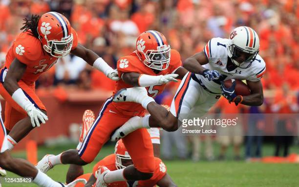 Trovon Reed of the Auburn Tigers is tackled by Jonathan Meeks of the Clemson Tigers during their game at Memorial Stadium on September 17, 2011 in...