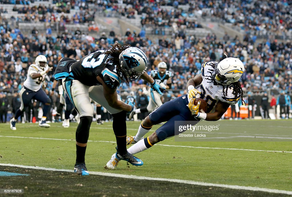 Trovon Reed #38 of the San Diego Chargers intercepts a pass to Kelvin Benjamin #13 of the Carolina Panthers in the 4th quarter during their game at Bank of America Stadium on December 11, 2016 in Charlotte, North Carolina.