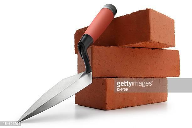 colher de pedreiro & tijolos - tijolo material de construção - fotografias e filmes do acervo
