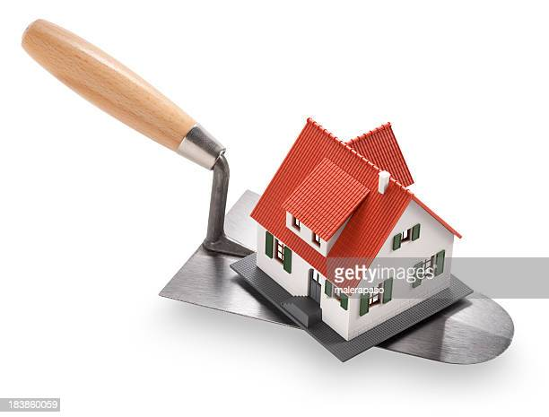 Trowel with a miniature model house