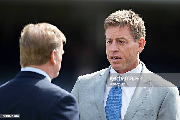 Troy Aikman and Commissioner Roger Goodell talk on the sidelines before a game between the Chicago Bears and the Green Bay Packers at Soldier Field...