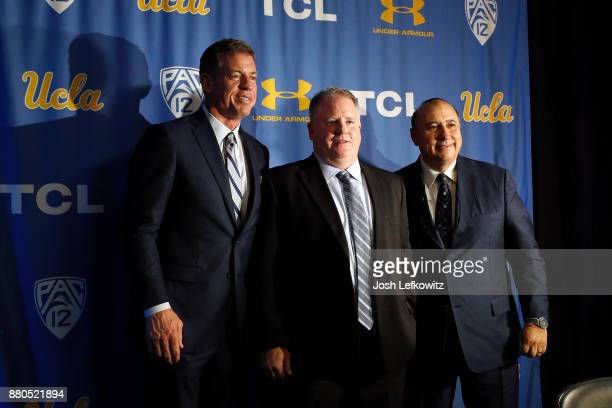 Troy Aikman, Chip Kelly and UCLA Director of Athletics Dan Guerrero stand on stage for a photograph after a press conference introducing Kelly as the...