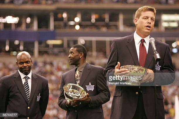 Troy Aikman, former Dallas Cowboys quaterback, speaks to the fans in front of former teammates Emmitt Smith and Michael Irvin during a ceremony...