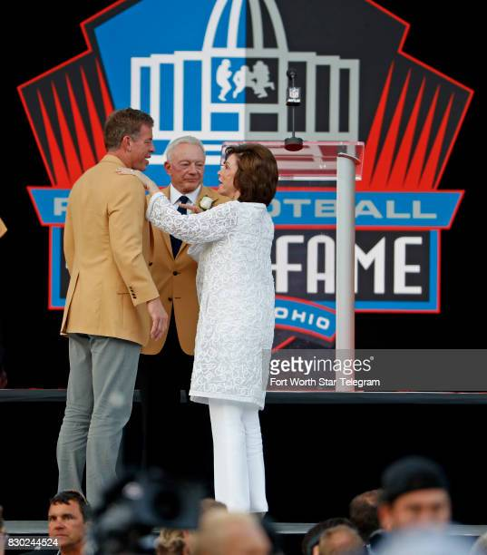 Troy Aikman Jerry and Gene Jones visit during a TV broadcast commercial break The 2017 NFL Hall of Fame class including Dallas Cowboys owner Jerry...