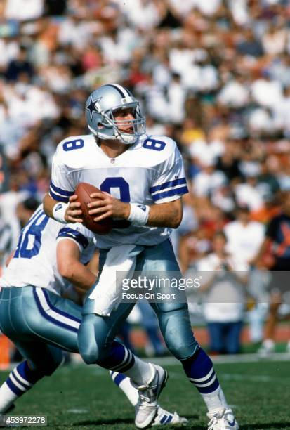 Troy Aikman of the Dallas Cowboys drops back to pass against the Los Angeles Raiders during an NFL football game October 25 1992 at the Los Angeles...