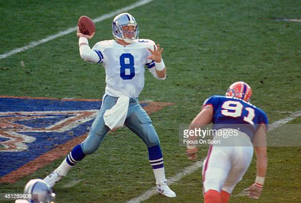 Troy Aikman of the Dallas Cowboys drops back to pass against the Buffalo Bills during Super Bowl XXVII on January 31 1993 at The Rose Bowl in...