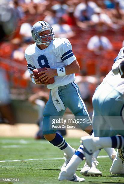 Troy Aikman of the Dallas Cowboys drops back to pass during an NFL football game circa 1989 Aikman played for the Cowboys from 198900