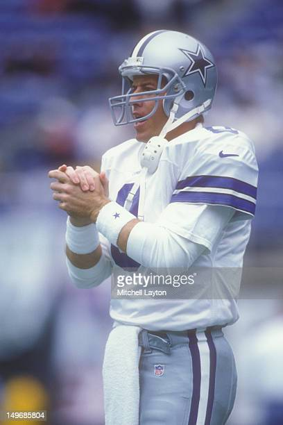 Troy Aikman of the Dallas Cowboys looks on during a NFL football game against the Philadelphia Eagles on September 17 1997 at Veterans Stadium in...