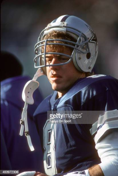 Troy Aikman of the Dallas Cowboys looks on from the sidelines during an NFL football game circa 1992 Aikman played for the Cowboys from 198900