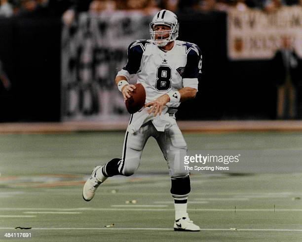 Troy Aikman of the Dallas Cowboys rolls out circa 1990s