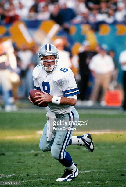 Troy Aikman of the Dallas Cowboys rolls out to pass against the Pittsburgh Steelers during Super Bowl XXX on January 28 1996 at Sun Devil Stadium in...