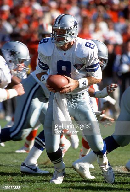 Troy Aikman of the Dallas Cowboys turns to hand the ball off to a running back against the San Francisco 49ers during the NFL Football game November...