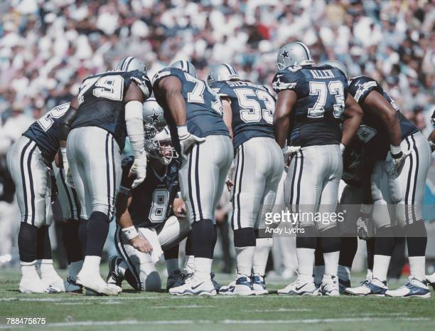 Troy Aikman Quarterback for the Dallas Cowboys in the huddle calling the play with his offensive line during the National Football Conference West...