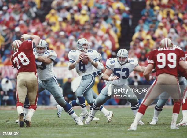 Troy Aikman Quarterback for the Dallas Cowboys prepares to throw as offensive lineman Mark Stepnoski covers during the National Football Conference...