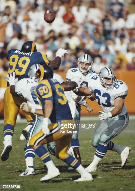 Troy Aikman Quarterback for the Dallas Cowboys throws the ball downfield during the National Football Conference West game against the Los Angeles...